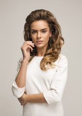 Young attractive woman in white
