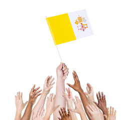 Diverse People Holding The Vatican City Flag