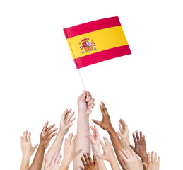 Group of Diverse People Holding The Flag of Spain