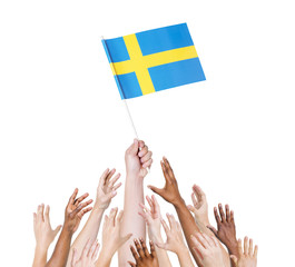 Diverse People HoldingThe Flag of Sweden
