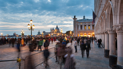 Tourists in San Marco square during Carnival of Venice. Italy.