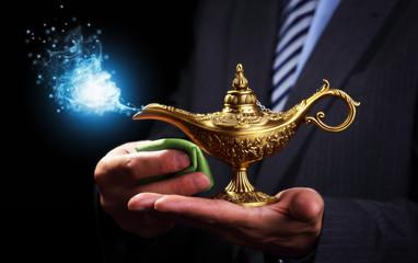 Rubbing magic Aladdins genie lamp