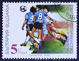A stamp printed in Bulgaria shows football, circa 1990