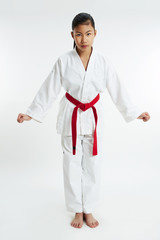 young taekwondo girl in salutation position