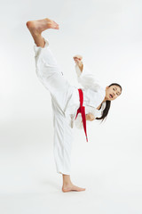 young taekwondo girl kicking