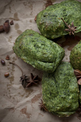 spinach plum cake with anise on spotted rustic paper