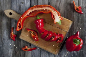 red pepper on chopping board on wooden table
