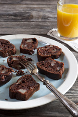 chocolate and pears cake and orange juice on wooden table