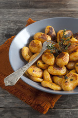 pumpkin dumplings italian gnocchi with thym on plate