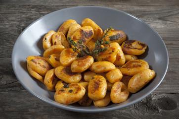 pumpkin dumplings italian gnocchi with thyme on plate