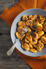 pumpkin dumplings italian gnocchi with thym on plate with napkin