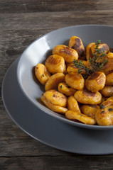 pumpkin dumplings italian gnocchi with thyme on plate