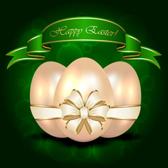 Decorative Easter egg with ribbon on green background
