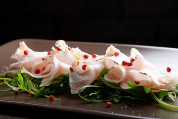 Slices of bacon Lardo di colonnata with red pepper