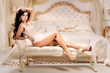 Fototapete - Fashion portrait of young elegant woman in bed