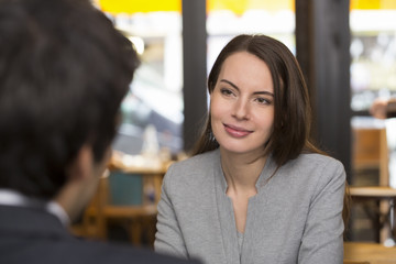 Portrait of beautiful woman with a man in restaurant
