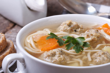 Soup with noodles and meatballs closeup