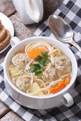 Soup with meatballs, noodles, potatoes vertical