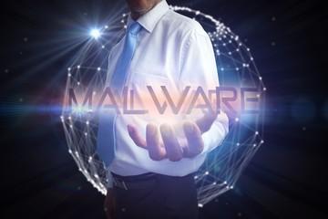 Businessman presenting the word malware