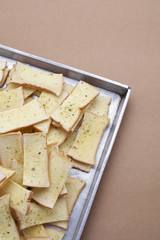 butter and herb bread on brown background