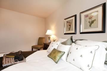 Light cream bedroom with refreshing bedding