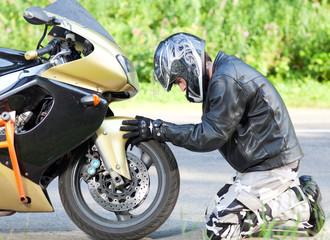 man near a motorcycle