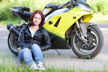 woman sitting near bike