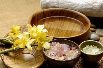Wall Mural - towels and herbal salt with bowl of water on mat