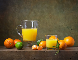Still life with citrus fruit and orange juice