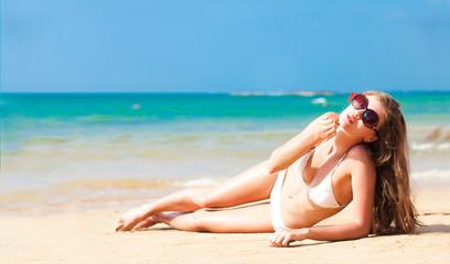 long haired woman in bikini on tropical beach