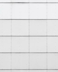 White industrial wall background texture with metal tiling