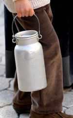 old bin to transport the milk brought by a young boy