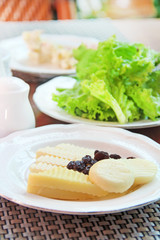 Arrangement of dairy products and lettuce on a table