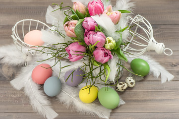 pink tulip flowers and easter eggs