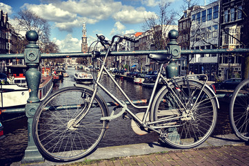 Old bicycle on bridge. Amsterdam cityscape