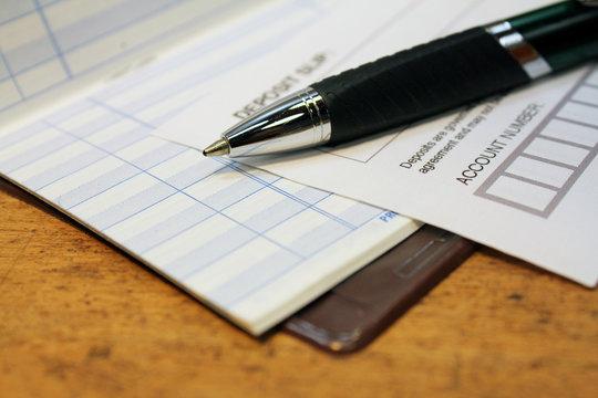 Deposit slip with check ledger