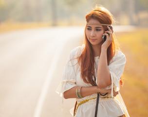 Hippie girl using mobile phone