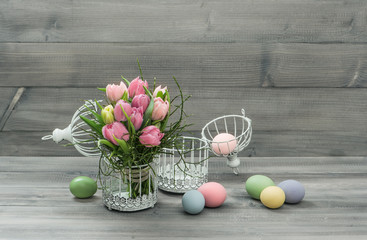 pastel pink tulip flowers and easter eggs