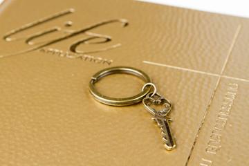 A golden key on bible