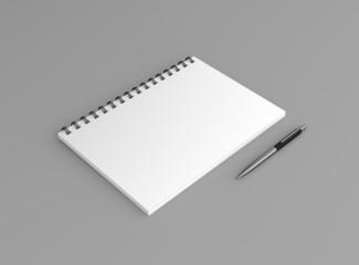 Noitzblock mit Kugelschreiber Hintergrund grau
