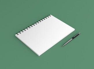 Noitzblock mit Kugelschreiber Hintergrund grün