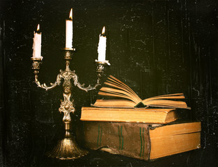 candlestick and books