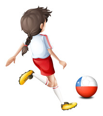 A female player kicking the ball with the flag of Chile