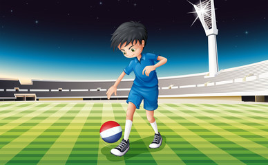 A soccer player kicking the ball with the flag of Netherlands