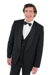 Cheerful groom in tuxedo