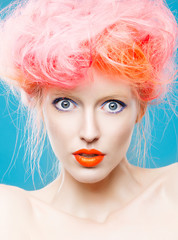 Portrait of beautiful girl with pink hair, surprise