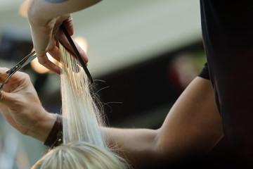 Barber cutting blond hair