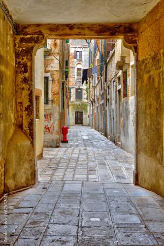 Wall mural Narrow street in Venice