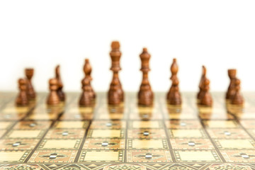 Chess strategy board game with 16 pieces in the background