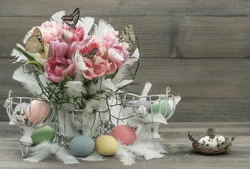 pink tulips, feathers, butterflies and easter eggs